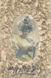three quarter length study, wearing large hat, yellow dress with much decoration