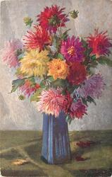 many colours of asters in blue angular vase