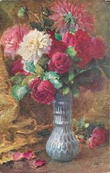 red roses & red, pink white asters in tall blue/grey vase