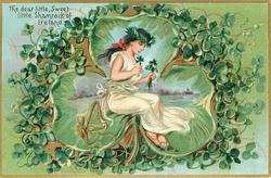 THE DEAR LITTLE, SWEET LITTLE SHAMROCK OF IRELAND  spirit in white holds shamrock