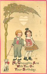 MY THOUGHTS ARE WITH YOU ON YOUR BIRTHDAY  boy has puppy on lead wrapped round tree as he flirts with girl, heart above
