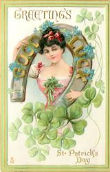 GREETINGS  GOOD LUCK  on horseshoe round girls neck  shamrock below & around