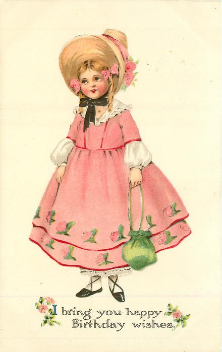 girl in old style pink dress stands carrying green purse
