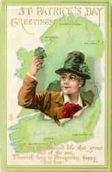 GREETINGS  MAY THE EMERALDS ISLE THAT GROWS OUT OF THE SEA, FLOURISH LONG IN PROSPERITY, HAPPY AND FREE  irishman holding shamrock breaks through map