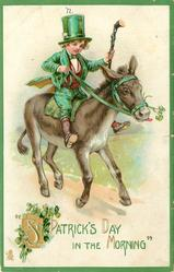 IN THE MORNING'  boy in green rides donkey