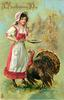 girl with plate in hand to feed tom turkey