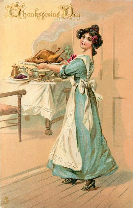 woman in blue dress walks left carrying cooked turkey into dining-room