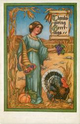 THANKSGIVING GREETINGS  woman in blue, facing right, cornucopia & turkey