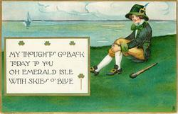 MY THOUGHTS GO BACK TODAY TO YOU OH EMERALD ISLE WITH SKIES O' BLUE  boyl sits with cudgel on grass at seaside