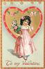 TO MY VALENTINE  girl in pink holding pot of pink roses stands in front of gilt heart