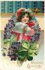 VALENTINE GREETINGS  girl in red coat, white muff, framed by circlet of violets