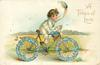 A TOKEN OF LOVE  boy on bicycle with floral wheels  image**