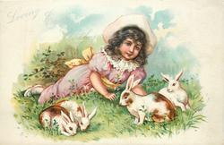 LOVING EASTER WISHES  girl lies on ground watching 4 rabbits