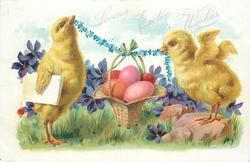 LOVING EASTER WISHES  two chicks hold forget-me-not rope from which Easter eggs hang in basket