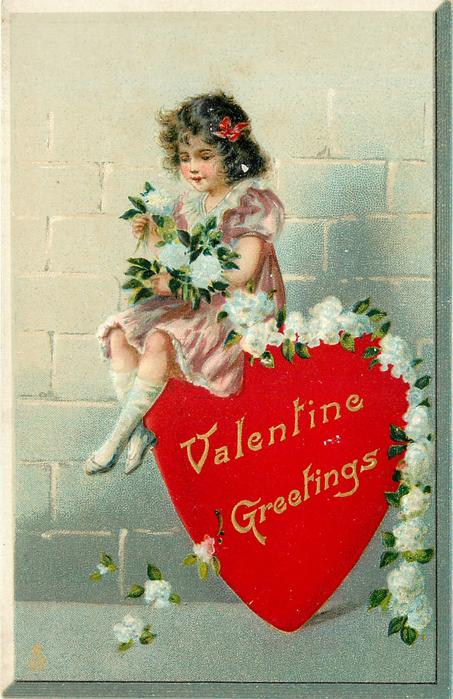 VALENTINE GREETINGS  girl in pink dress holds rope of white flowers whilst sitting on red heart