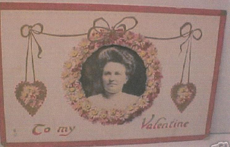 TO MY VALENTINE  head & shoulders of woman in insert ringed by small pink daisies,  gilt hearts on either side of inset