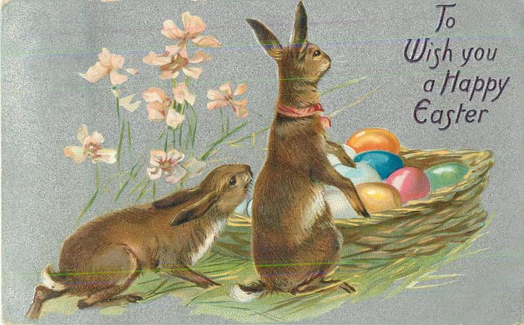 TO WISH YOU A HAPPY EASTER  two rabbits front look back at basket of Easter eggs