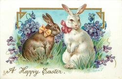 A HAPPY EASTER  brown rabbit with orange bow left, white rabbit with red bow right, violets around