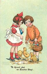 TO GREET YOU ON EASTER DAY  girl & boy feed three chicks on ground
