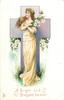 A BRIGHT AND BLESSED EASTER  woman in yellow dress, arms crossed holding lilies, before cross