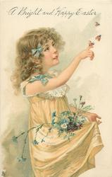 A BRIGHT AND HAPPY EASTER  girl dressed in cream, flowers in her skirt holds finger to butterflies