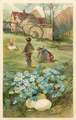 A HAPPY EASTER  three children in meadow, forget-me-nots over eggs in front