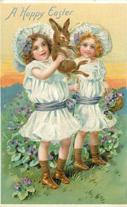 A HAPPY EASTER  two girls, one holds rabbit, the other a basket in left hand & closed umbrella in right