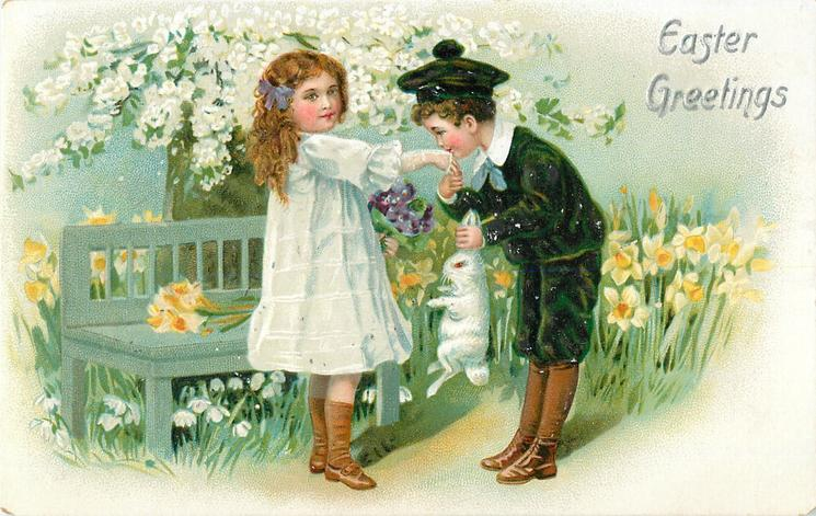 EASTER GREETINGS  boy kisses hand of girl while he holds rabbit up by the ears with his left hand