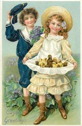 EASTER GREETINGS  boy lifts hat as he stands behind girl who cradles chicks in her apron