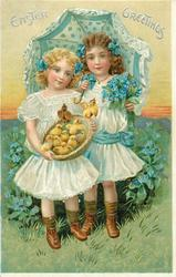 EASTER GREETINGS  two girls, one holds basket of chicks,  the other holds an open parasol