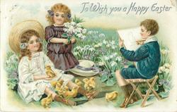 TO WISH YOU A HAPPY EASTER  two girls sit in grass, one plays with chicks, other has flowers, boy draws chick
