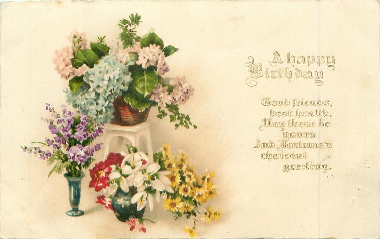 A HAPPY BIRTHDAY three vases of various flowers