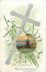 A JOYFUL EASTERTIDE  cross tilts right, round insert of windmill, snowdrops