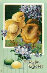 A JOYFUL EASTER  two chicks peck at violets upper right, green and yellow egg below left, violets