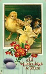 ALL EASTER JOYS BE YOURS  three chicks, holding on to ear of wheat, two purple eggs lower left, red polyanthus