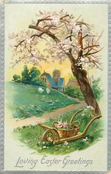 LOVING EASTER GREETINGS  wheelbarrow with basket of flowers, two distant sheep