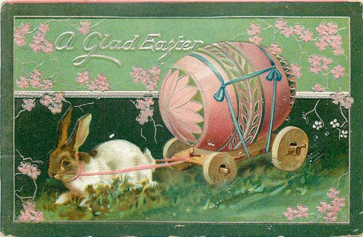 A GLAD EASTER  white rabbit with brown head pulling cart with pink egg
