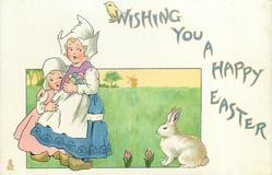 WISHING YOU A HAPPY EASTER  two Dutch girls left, rabbit right