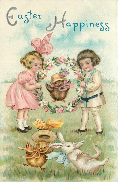 EASTER HAPPINESS  chicks in bonnets jump through floral hoop held by boy & girl, also a white rabbit