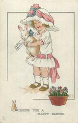 WISHING YOU A HAPPY EASTER  girl holds up rabbit with EASTER GREETINGS label
