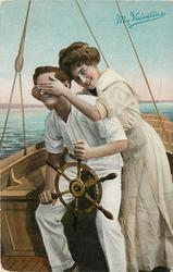 MY VALENTINE  couple on sailing boat, he holds the wheel, she stands with hands over his eyes