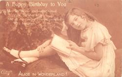 A HAPPY BIRTHDAY TO YOU girl seated with book on knees, bending right looking front