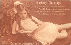 BIRTHDAY GREETINGS girl looks down reading book