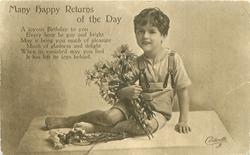 MANY HAPPY RETURNS OF THE DAY  boy with armful of daisies sits facing left/front