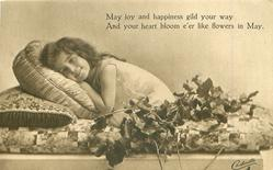 MAY JOY AND HAPPINESS GILD YOUR WAY AND YOU HEART BLOOM E'ER LIKE FLOWERS IN MAY  girl on couch, crouching forward, ivy around
