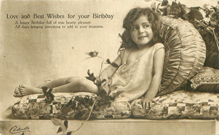 LOVE AND BEST WISHES FOR YOUR BIRTHDAY   girl on lies back on couch, facing left, looking front/right, ivy around