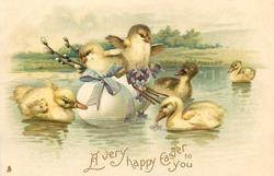 A VERY HAPPY EASTER TO YOU  two chicks in egg boat, blue ribbon & flowers,ducklings around