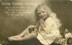 LOVING BIRTHDAY GREETINGS  girl sitting facing left, looking front, hands to face, lilac around