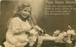 MANY HAPPY RETURNS   smiling girl sitting facing right, looking front, holding lilac