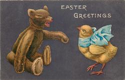 EASTER GREETINGS  teddy bear, wearing blue bow reaches paw to chick